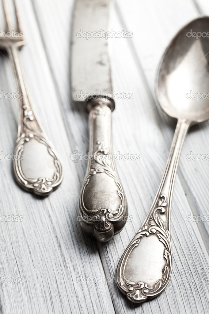 Old cutlery on wooden table — Stock Photo #14747363