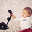 Little baby with old vintage phone — Stock Photo
