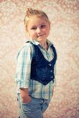 Portrait of little girl before retro background — Stock Photo