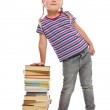 Little girl with a pile of books — Stock Photo