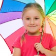 Little girl with umbrella. - Stok fotoğraf