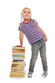 Little girl with a pile of books — Foto Stock