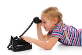 Little girl with old retro phone. — Stockfoto