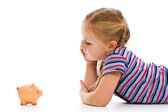 Little girl with piggy bank — 图库照片
