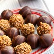 Chocolate pralines in plate — Stock Photo