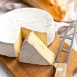 Camembert cheese on kitchen table — Stock Photo