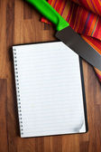 Blank recipe book and kitchen knife — Stock Photo