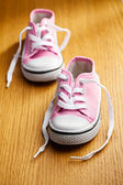Pink baby sneakers — Stock Photo