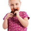 Young girl eating a chocolate bar. — Stock Photo #18636301