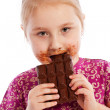 Young girl eating a chocolate bar. — Stock Photo