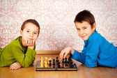 Young boys playing chess — Stock Photo