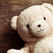 Teddy bear on old wooden background - Stock Photo