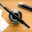 Stock Photo: Fountain pen and inkwell on desk
