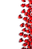 Red glass hearts on white background — Stock Photo