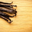 Vanilla pods on kitchen table — Stockfoto