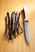 Vanilla pods with knife — Stock Photo
