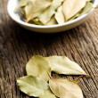 Bay leaves on old wooden table — Foto Stock
