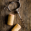 Stock Photo: Wine cork and corkscrew