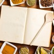 Cookbook and various spices and herbs. — 图库照片