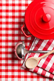 Kitchenware on checkerd tablecloth — Stock Photo