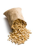 Wooden pellets in jute sack — Stock Photo