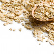 Oat flakes on a wooden spoon - 