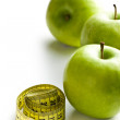 Green apple and measuring tape — Stock Photo #21902485