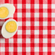 Two halves of a boiled egg - Stock Photo