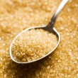 Brown sugar in silver spoon — Foto de Stock