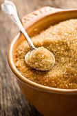Brown sugar in silver spoon — Stock Photo