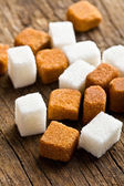 Brown and white sugar cubes — Stock Photo