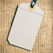 blank price tag label on burlap background  — Stock Photo