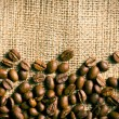 Coffee beans on burlap background — Stock Photo #24788237