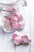 Sweet marshmallows in glass jar — Stock Photo
