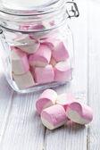 Sweet marshmallows in glass jar — Stock Photo