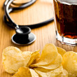 Unhealthy food. Salty crisps. — Stock Photo #25805241
