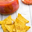 Corn nachos with tomato dip — Stock Photo