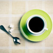 Black coffee in green cup — Stock Photo