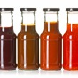 Foto Stock: Various barbecue sauces in glass bottles