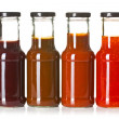 Various barbecue sauces in glass bottles — Stock fotografie #26447793