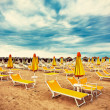 Sunbeds and parasols on the beach — Stock Photo