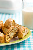 Cantuccini cookies on checkered tablecloth — Stockfoto