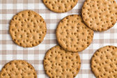 Crispbread on checkered tablecloth — Stock Photo