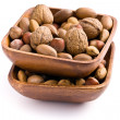 Various unpeeled nuts in wooden bowl — Stock Photo