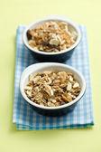 Muesli in ceramic bowls — Stock Photo
