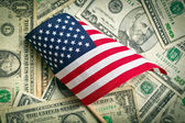 American flag with us dollars — Stock Photo