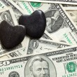 Stone hearts on us dollars — Stock Photo