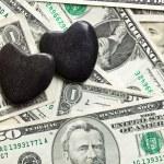Stone hearts on us dollars — Stock Photo #32454721