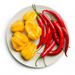 Chili peppers and habanero on plate — Stock Photo