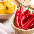 Red peppers and habanero in bowls — Stock Photo